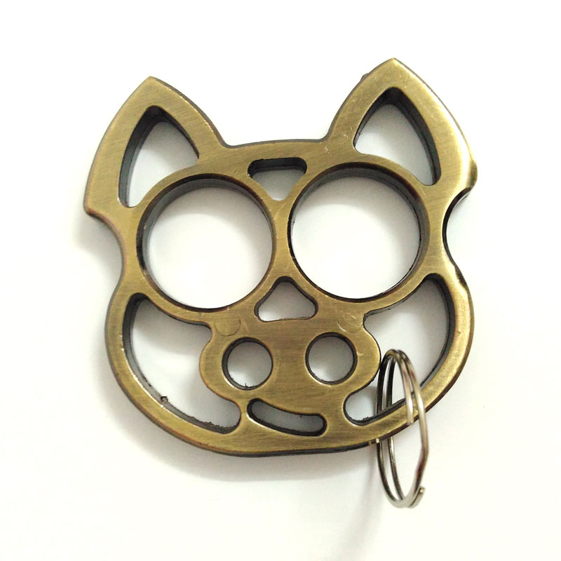 Creative Mini Cartoon Pig Knuckles Self Defense Protection Keychain ... 96b65b67670c